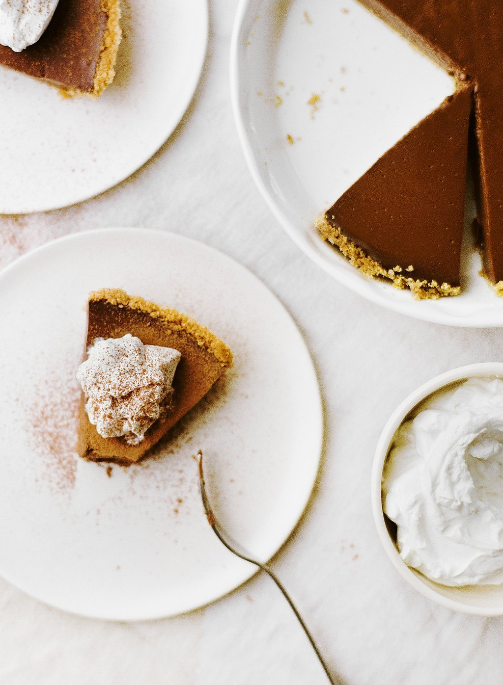 One of my all-time favorites, this Chocolate Pudding Pie features a graham cracker crust, rich double chocolate pudding filling, and whipped cream on top!