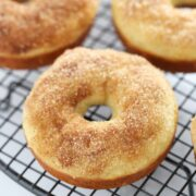 Maple Cinnamon Sugar Baked Donuts take less than 30 minutes to make and are lightened up with yogurt. Perfect quick & easy fall treat!