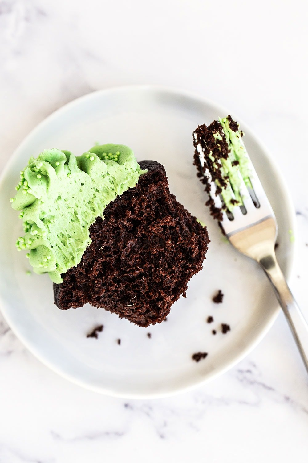 Chocolate mint cupcake on a plate with a fork