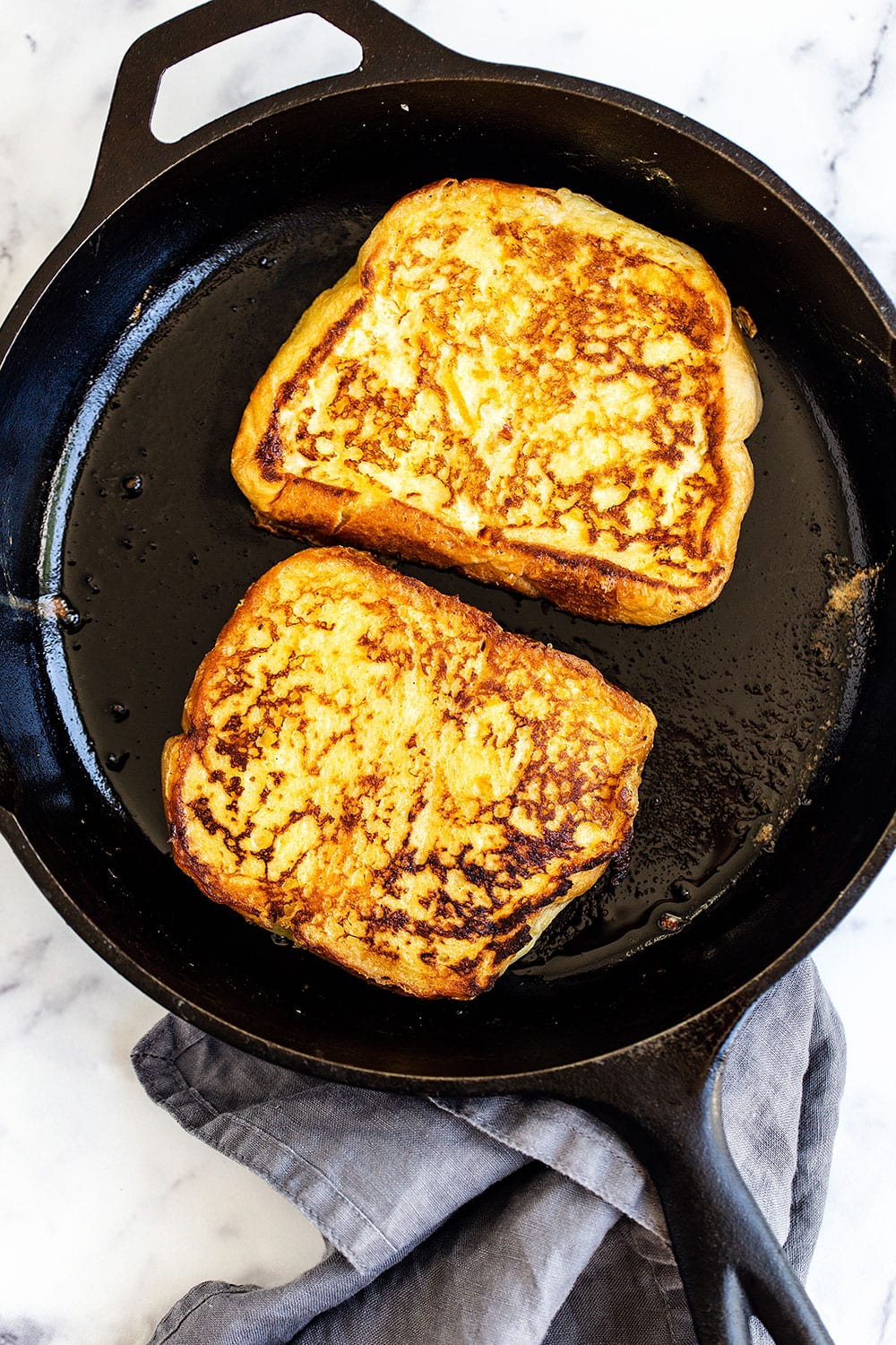 Easy French Toast frying in a cast iron skillet