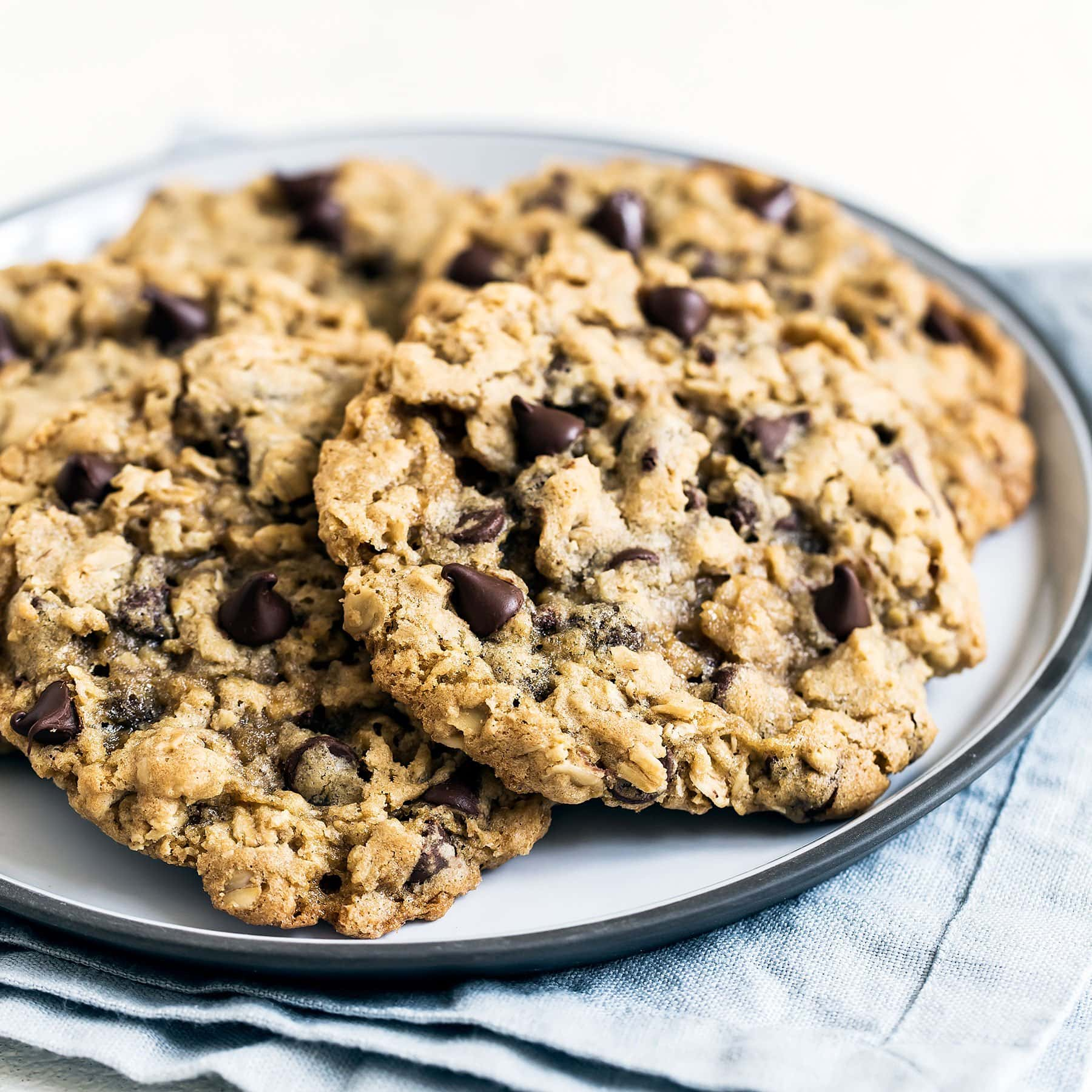 Thick, chewy, and soft, these oatmeal chocolate chip cookies are bursting with ooey gooey chocolate goodness that everyone will love.