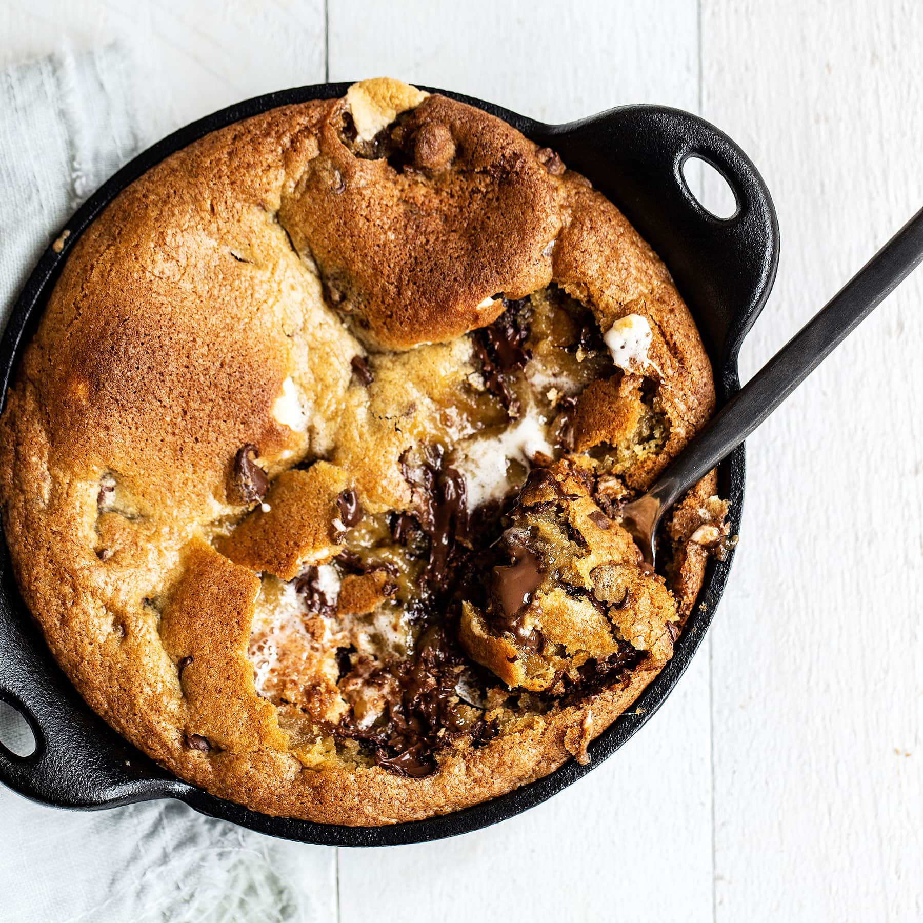 Gooey pizookie stuffed with marshmallow, Hershey's bars, and graham cracker bits