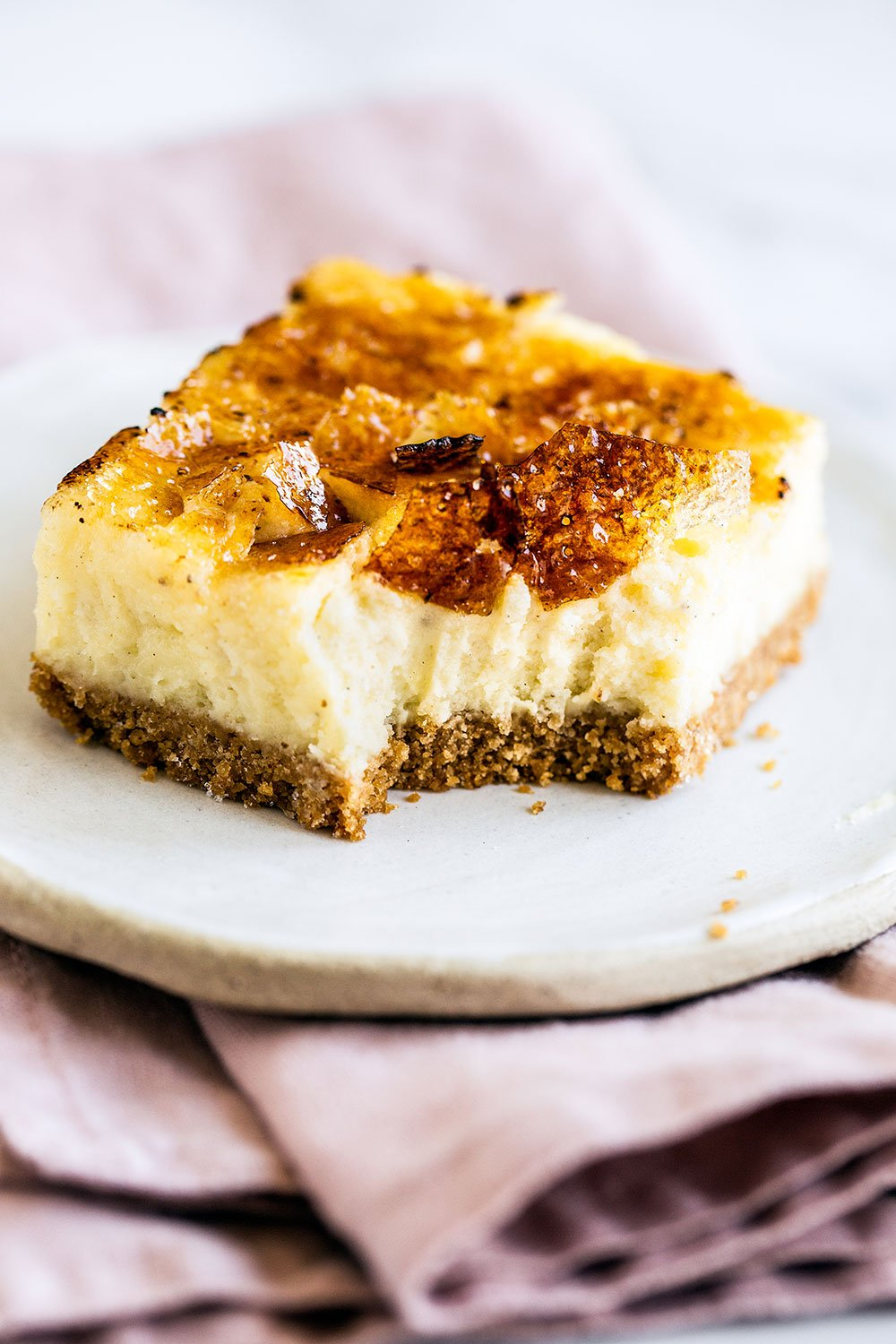 These Creme Brulee Cheesecake Bars turn the classic French dessert into something even easier and tastier! Graham cracker crust, vanilla bean cheesecake filling, and a bruleed sugar topping. YUM!