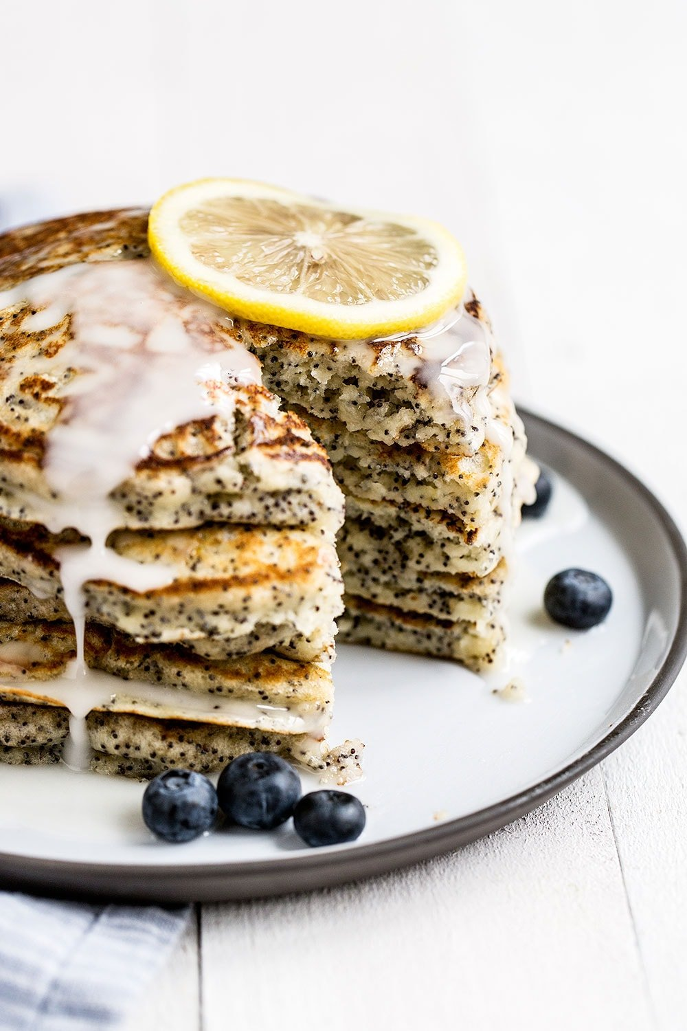 Homemade lemon poppyseed pancakes are ultra fresh, light, and fluffy and perfect for spring!