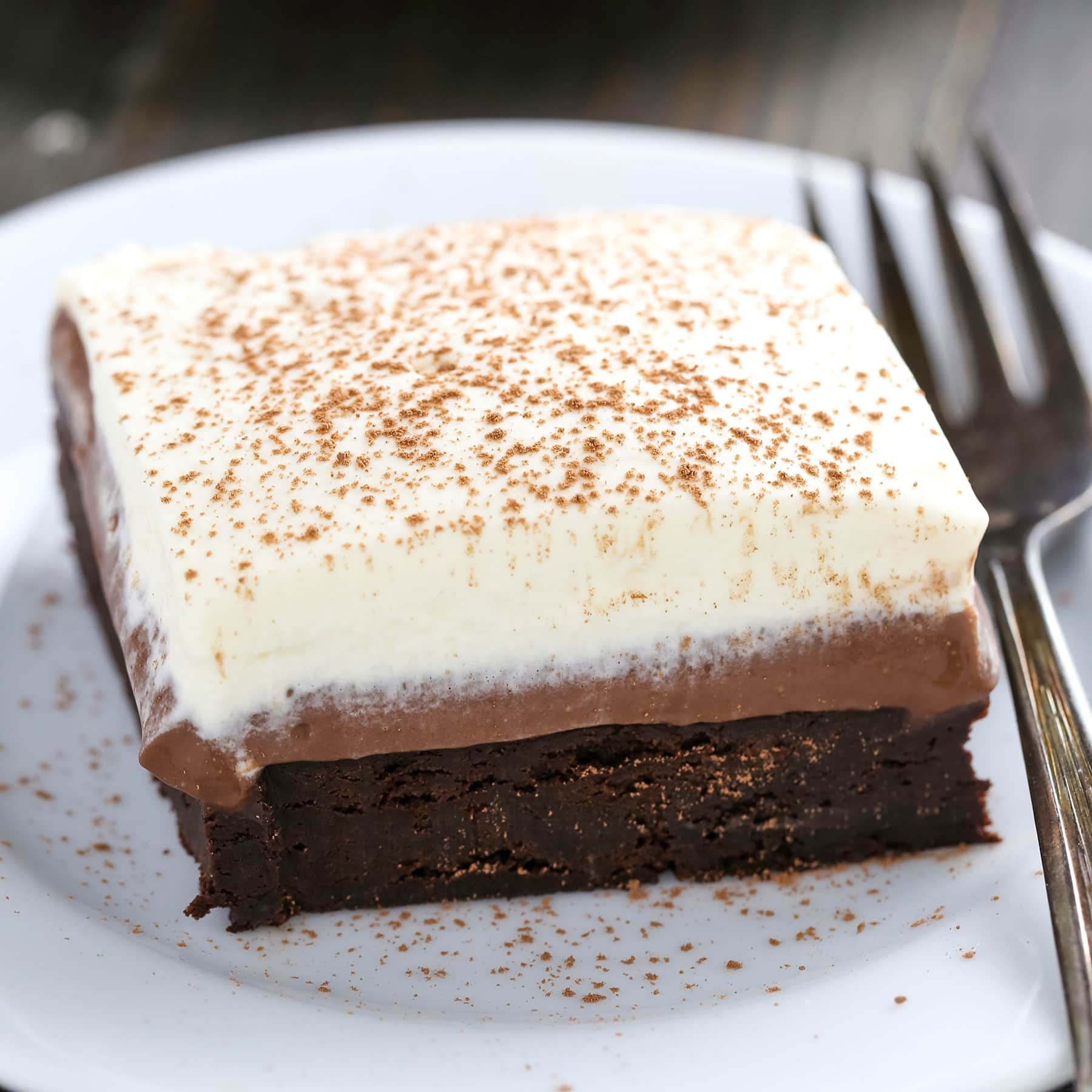 Chocolate Cream Pie Brownies have a rich fudgy brownie bottom, a layer of luscious chocolate cream pie filling, and are topped with homemade whipped cream.