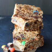 Monster Cookie Bars are filled with oatmeal, peanut butter, chocolate chips, and leftover Halloween candy!