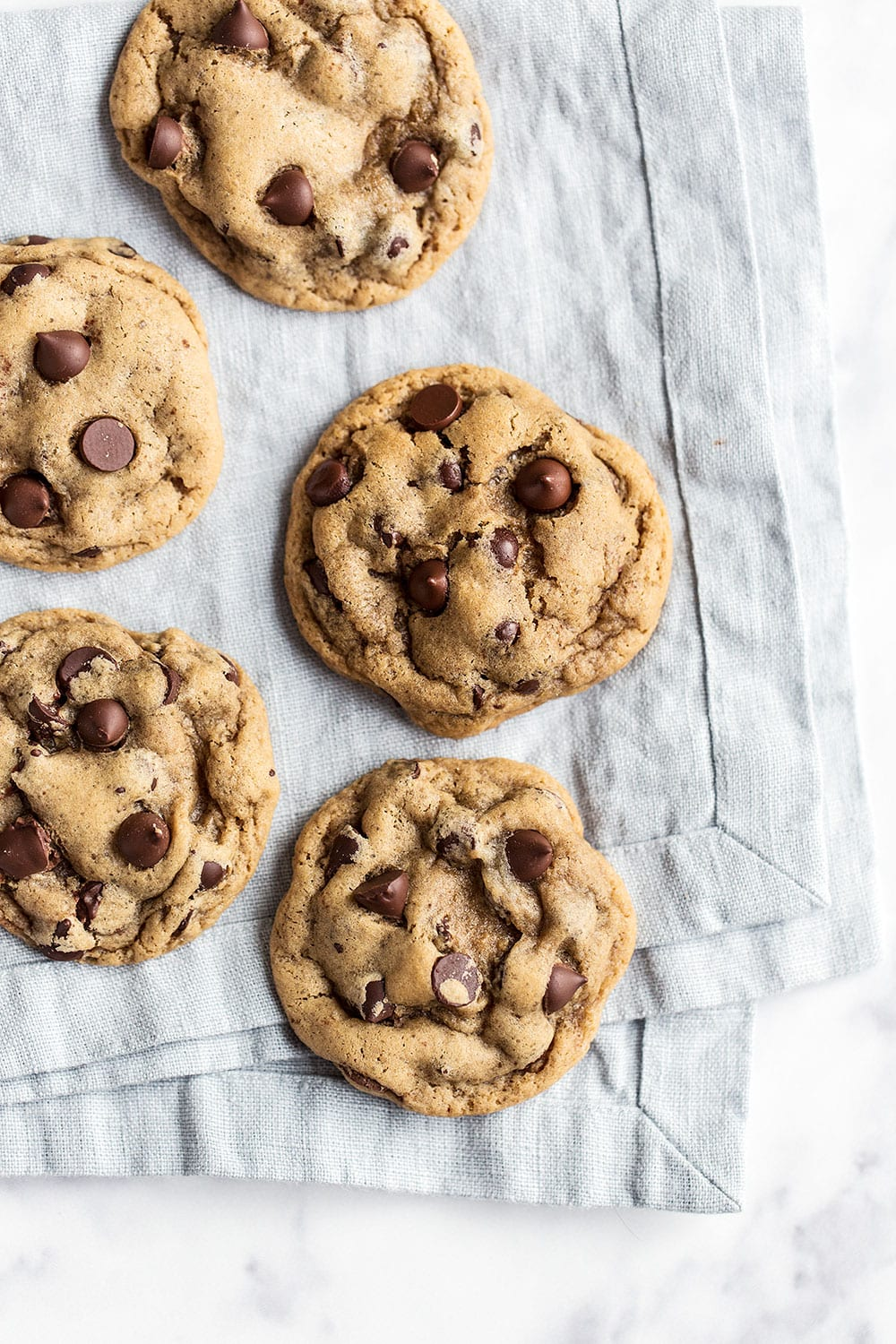 If you love SOFT and slightly gooey chocolate chip cookies you will be obsessed with this homemade recipe!