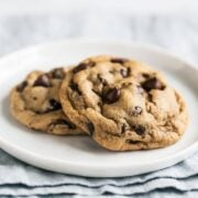 Soft Chocolate Chip Cookies are ultra ooey and gooey with two secret ingredients to keep them ultra soft and tender! Your friends will LOVE these cookies.