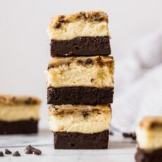 Layer of brownie, layer of cheesecake, and layer of chocolate chip cookie make these brownies absolutely sinful!