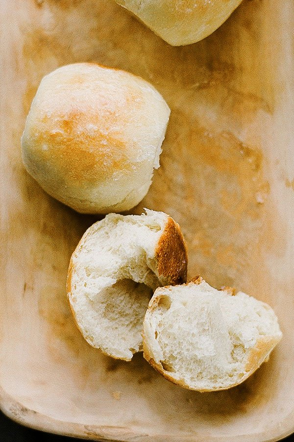 This simple recipe for ultimate dinner rolls makes beautifully golden brown rolls with a soft and fluffy texture! You won't believe how easy these are! Tons of tips and step-by-step video