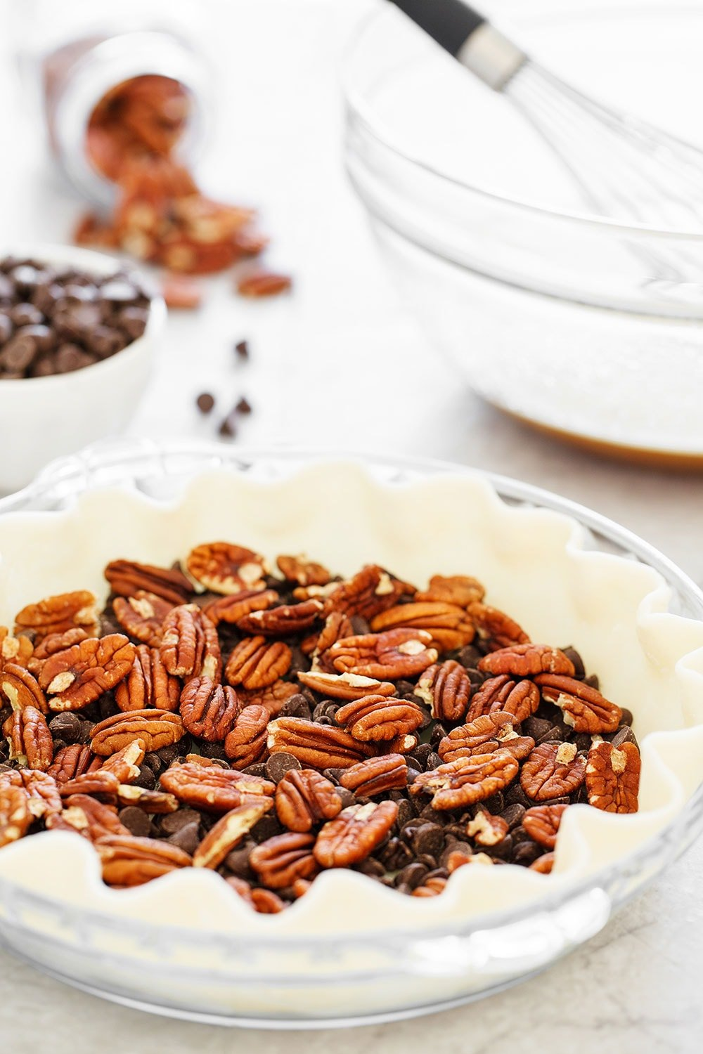 Homemade chocolate pecan pie in buttery pie dough ready to bake in the oven for Thanksgiving