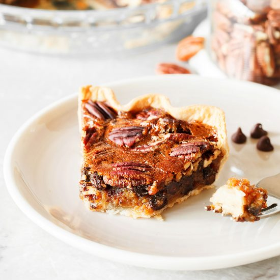 Chocolate Pecan Pie is perfect for Thanksgiving and has an ooey, gooey, yet crunchy filling with a buttery and flaky homemade pie crust!