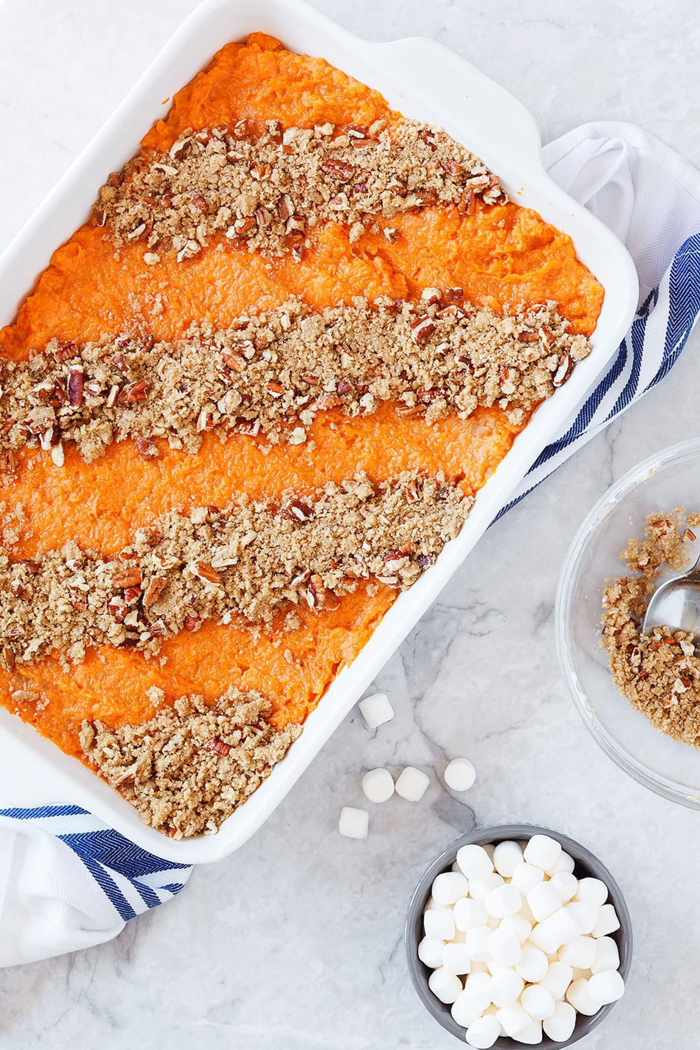 This crowd-pleasing sweet potato casserole has both a pecan topping and a marshmallow topping for the best of both worlds!