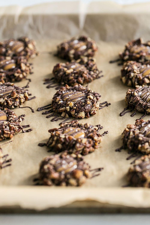 Chocolate, caramel, and pecan thumbprint cookies