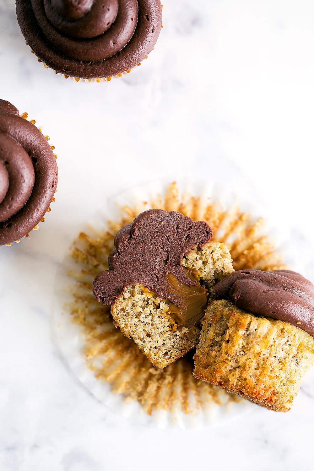 YUM! Dulce de Leche Banana Cupcakes with Chocolate Frosting are out of this world moist and flavorful!