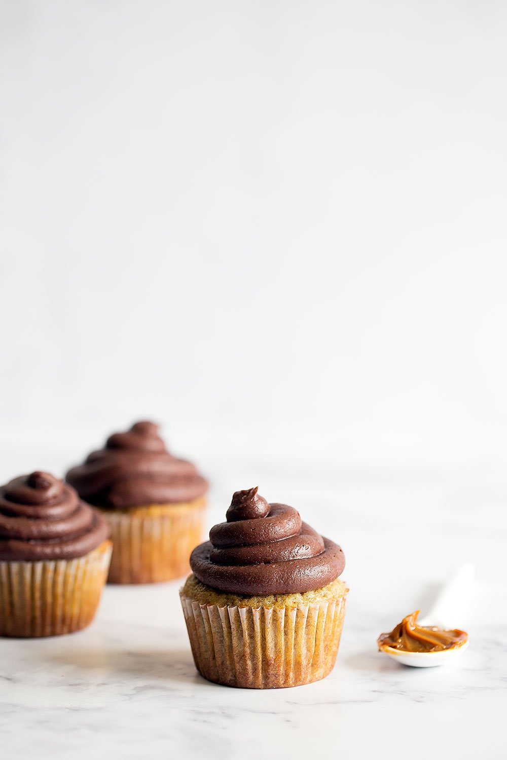 Dulce de Leche Banana Cupcakes with Chocolate Frosting are out of this world moist and flavorful!