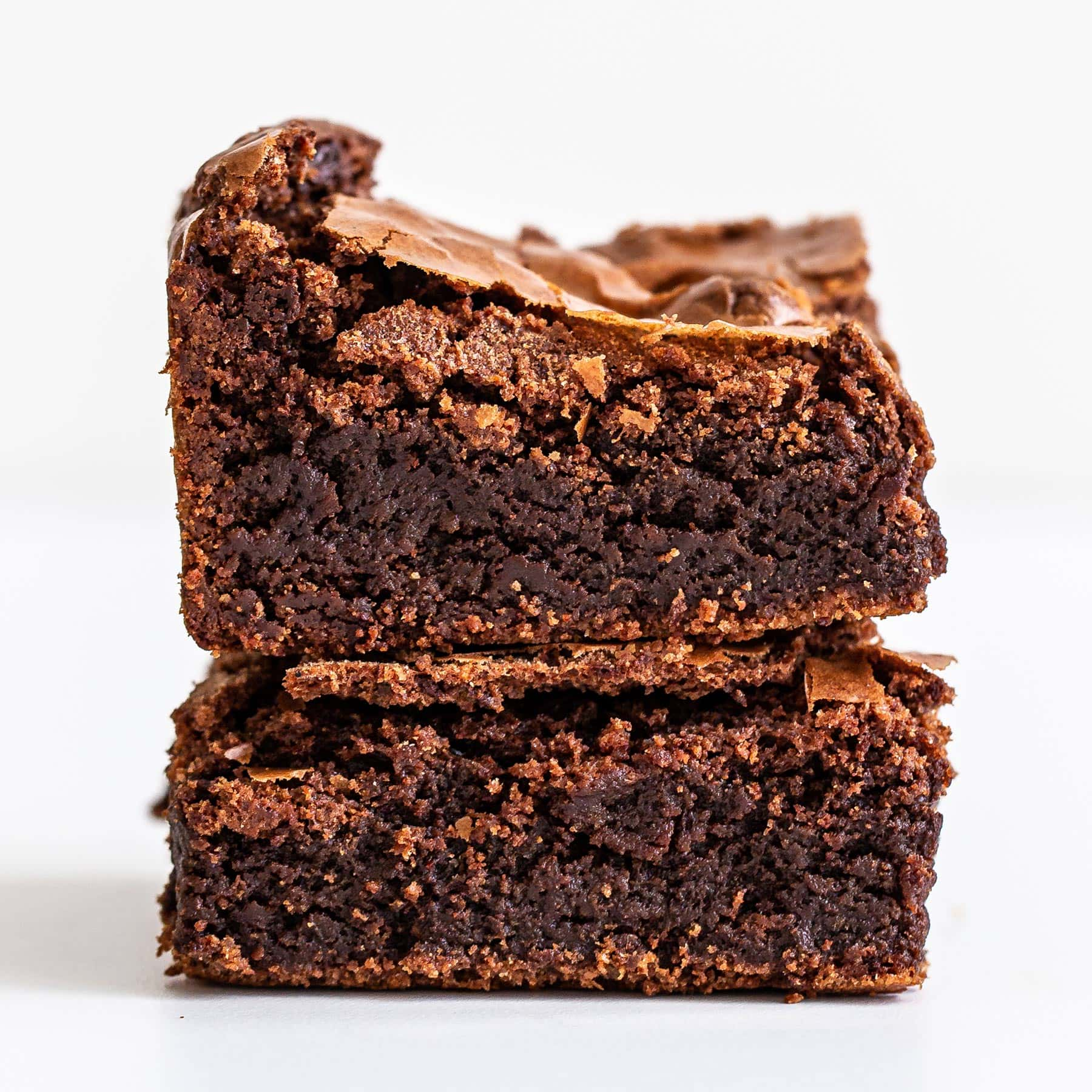 ultimate fudgy brownies stacked on top of each other
