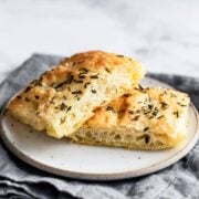 Two slices of rosemary focaccia bread on a plate