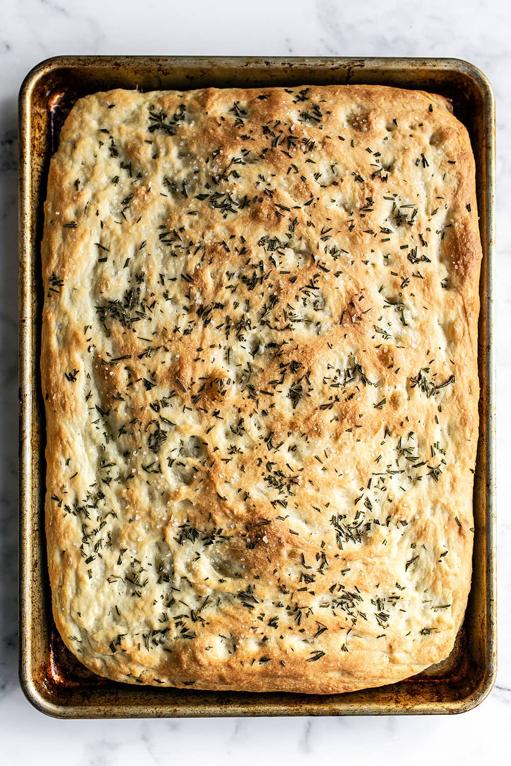 Tray of homemade rosemary focaccia bread fresh from the oven