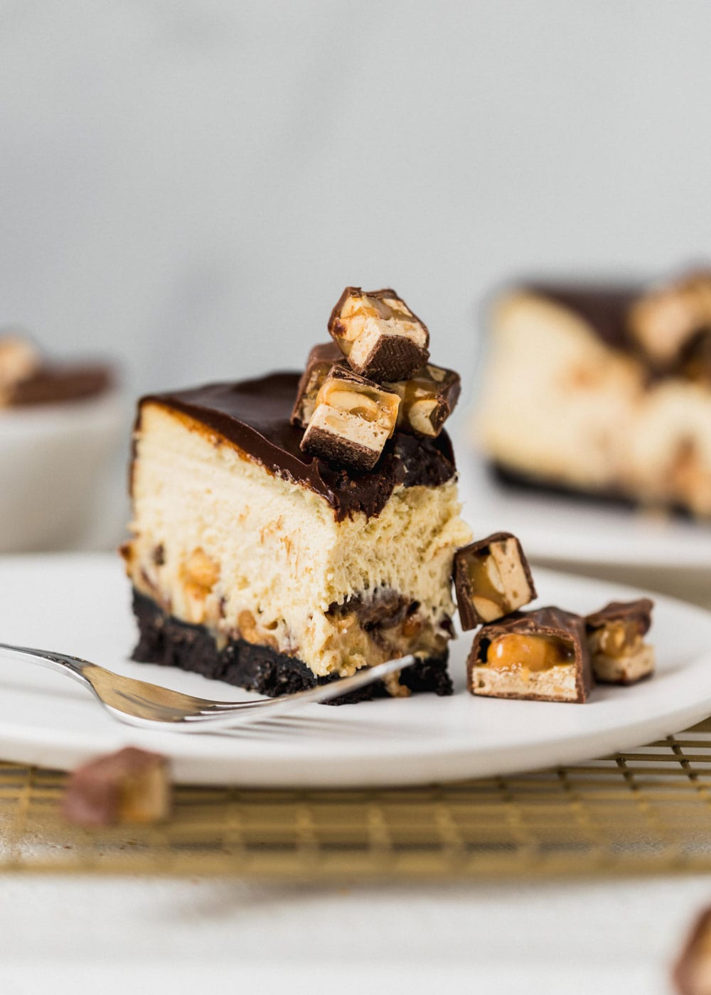Who could resist this over the top Snickers Cheesecake?!