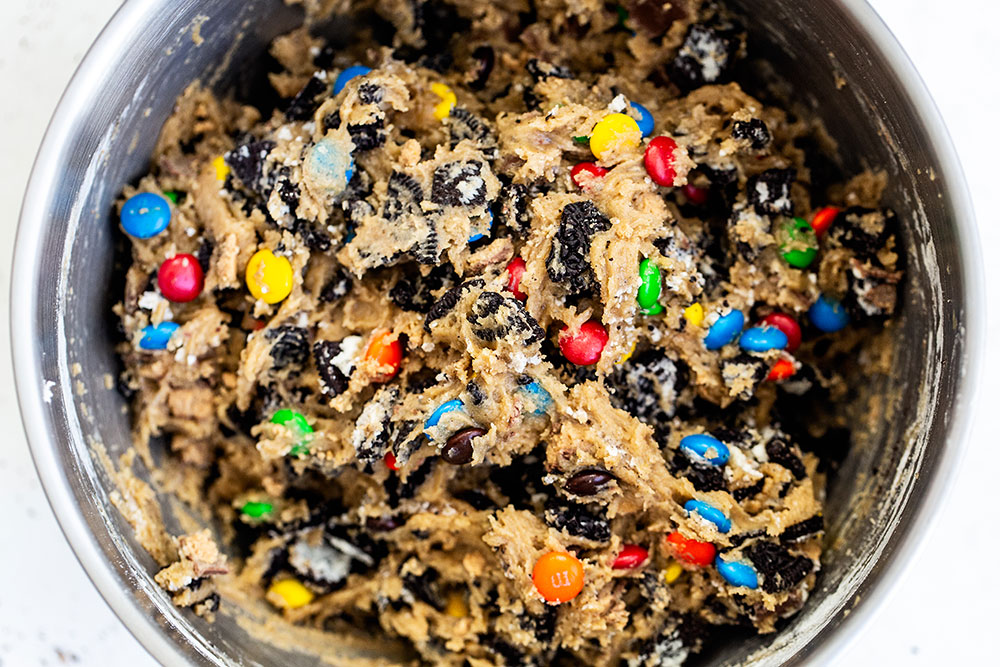 Loaded cookie dough with chopped Oreos, M&Ms, and Reese's