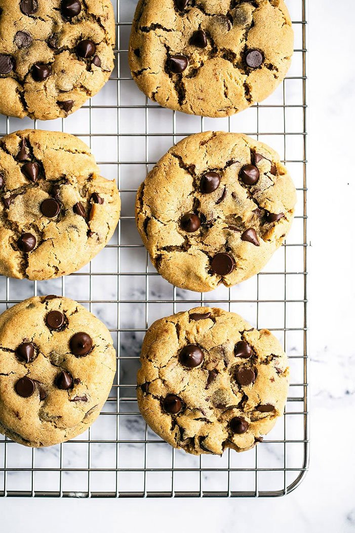 Peanut Butter Chocolate Chip Cookies are big, thick, chewy, and soft and loaded with peanut butter and chocolate flavor. They are outrageously good! No stand mixer required.