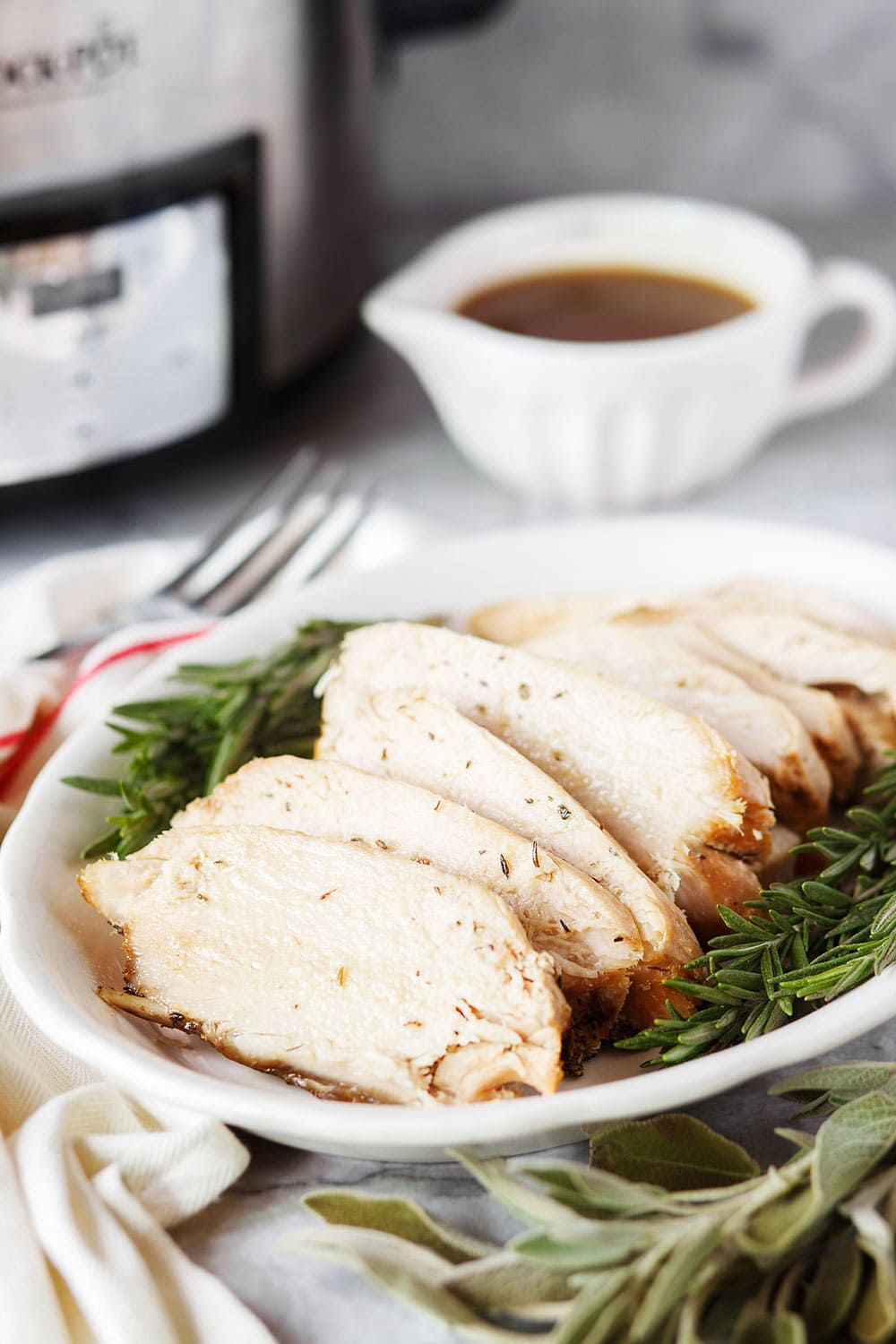 Crock Pot Thanksgiving Turkey Breast with easy gravy requires just 10 minutes prep time and doesn't take up valuable space in your oven on Thanksgiving! Plus it's extra tender and moist, it's a win-win!!