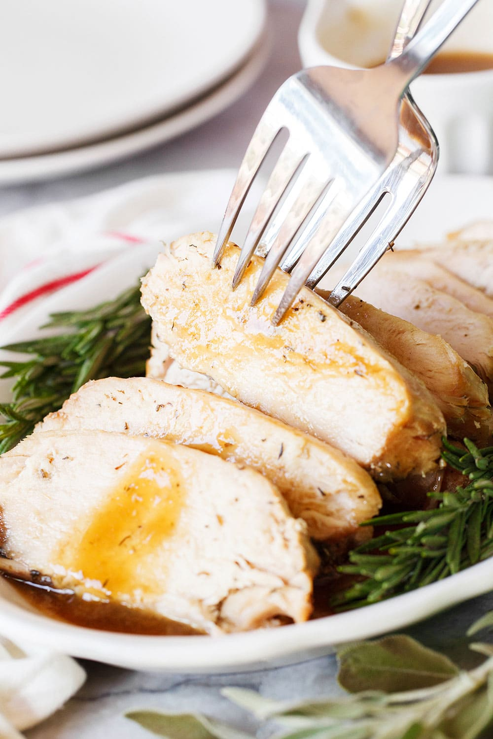 Slow Cooker Turkey Breast with easy gravy requires just 10 minutes prep time and doesn't take up valuable space in your oven on Thanksgiving! Plus it's extra tender and moist, it's a win-win!!