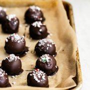 Easy Christmas Oreo truffles chilling on a tray