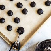 Crushed Oreos being formed into truffles