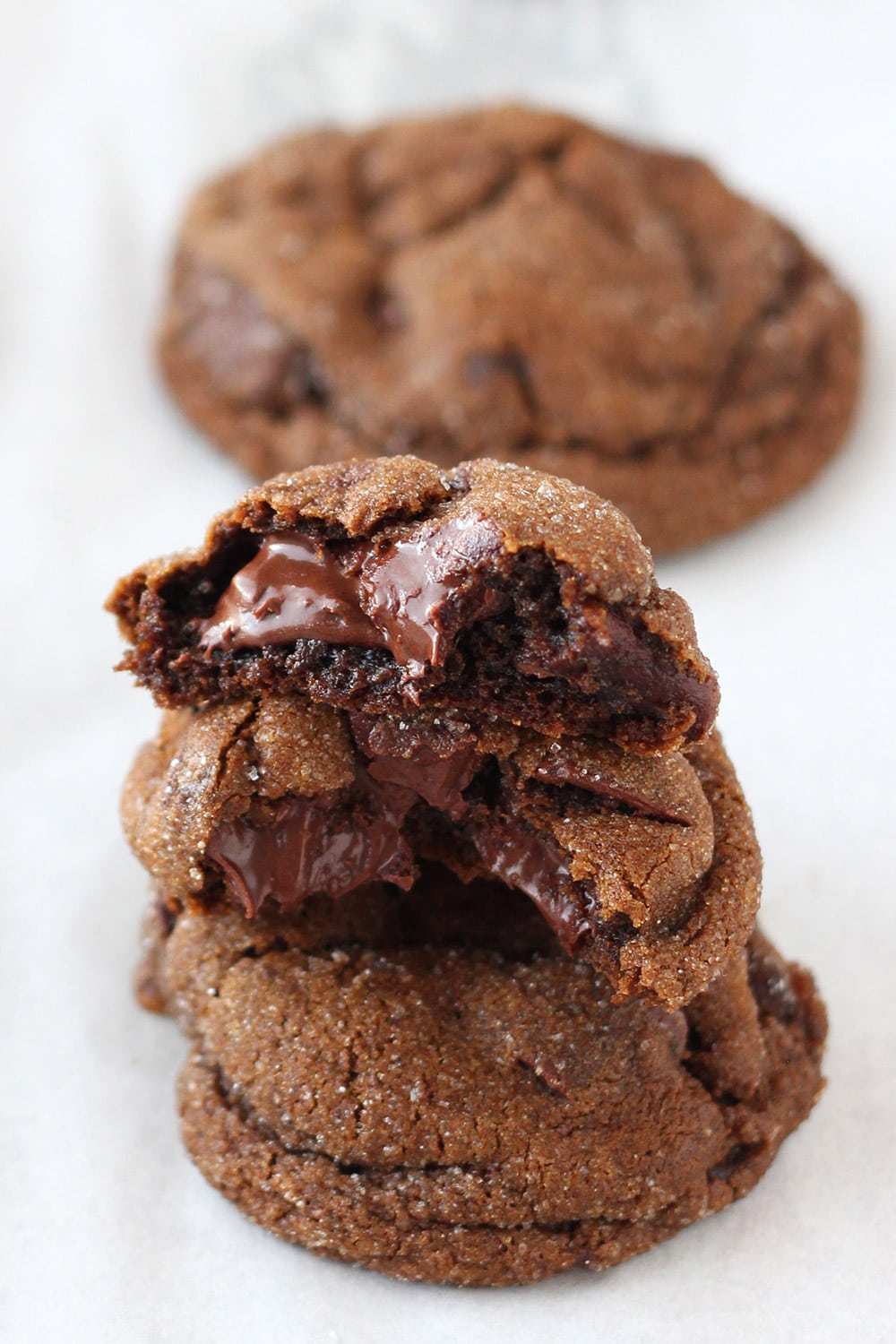 soft and chewy chocolate gingerbread cookies stacked on top of each other