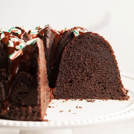 Peppermint Mocha Bundt Cake is the absolute PERFECT holiday cake! It's as easy as it is beautiful and loaded with chocolate, coffee, and peppermint flavors.