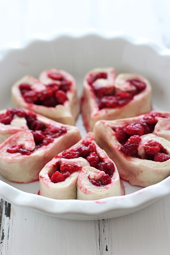 How ADORABLE are these for Valentine's Day!? Heart Shaped Raspberry Rolls