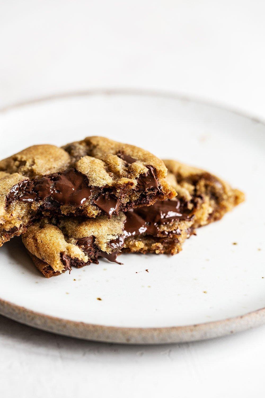 Chocolate chip cookie broken in half with gooey chocolate