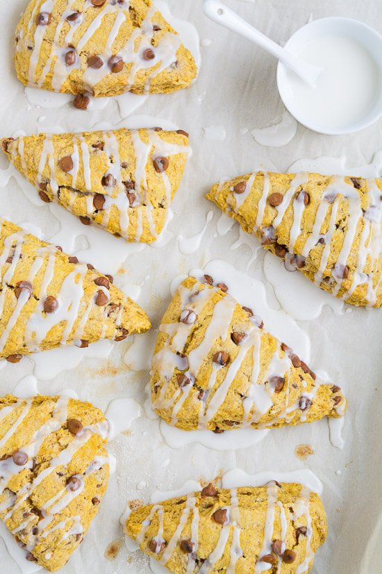Begin your mornings this fall with these scrumptious glazed cinnamon chip Pumpkin Scones.
