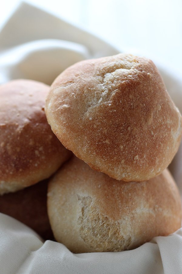 Scratch-made no-knead crusty bread rolls take just 5 minutes to prep and taste just as good as any bakery or restaurant-quality bread! Can be made ahead too!