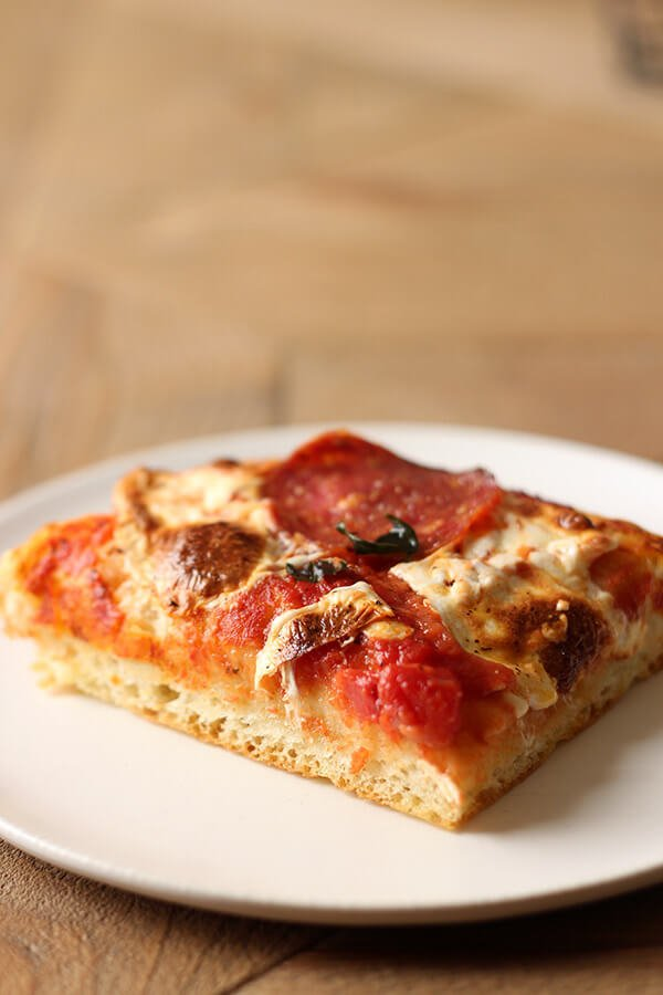 Focaccia Pizza is undoubtedly one of the BEST pizzas I've ever had! Thick and chewy homemade focaccia crust topped with easy tomato sauce and mozzarella. You'll LOVE it!