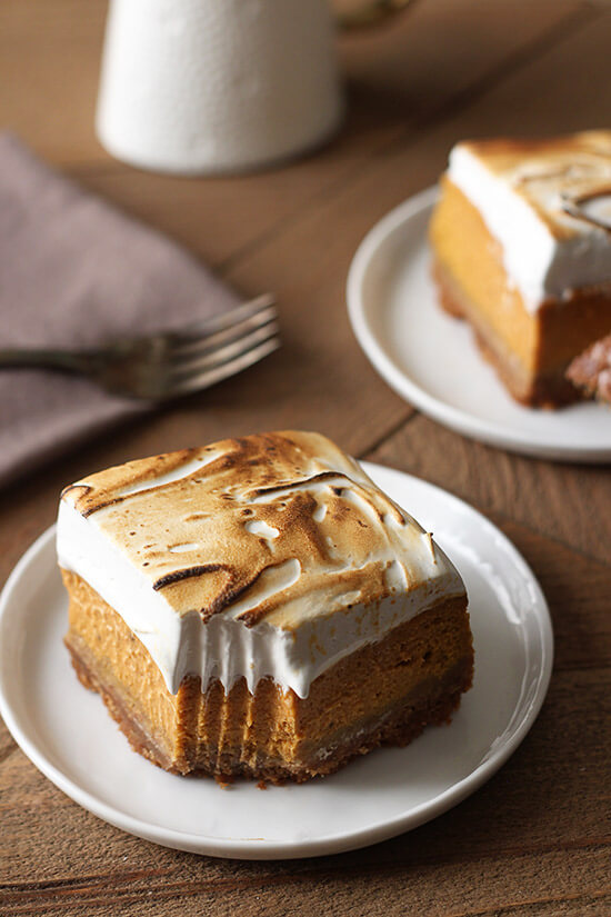 Sweet Potato Pie Bars with a thick graham cracker crust, fresh sweet potato filling, and tall toasted homemade marshmallow topping. Perfect fall treat!