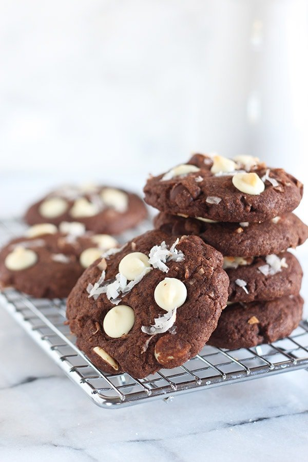 Chocolate Coconut Cookies are jam packed with that tropical and sweet coconut flavor AND three kinds of chocolate! Made in less than 30 minutes with no mixer required.