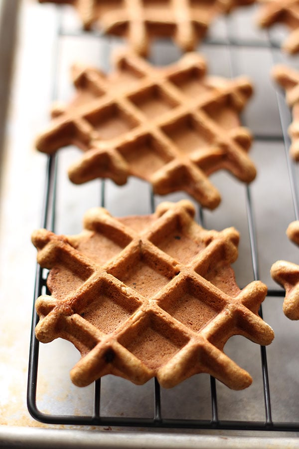 Gingerbread Doughnut Waffles with Maple Glaze are the yummy love child between aromatic gingerbread, sweet doughnuts, and waffles. Breakfast perfection!