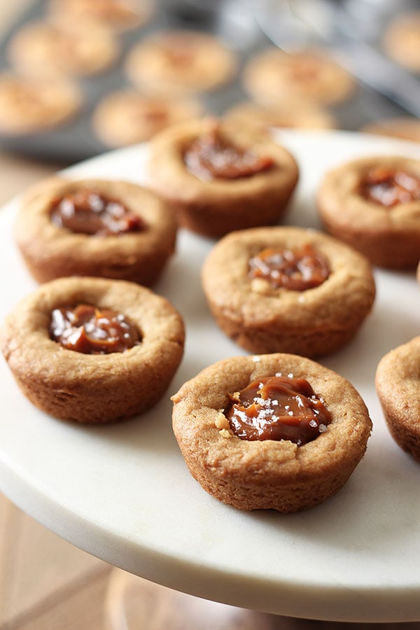 Brown Butter Dulce de Leche Cookie Cups feature an ultra chewy mini cookie cup filled with dulce de leche and sprinkled with sea salt. Pure heaven!