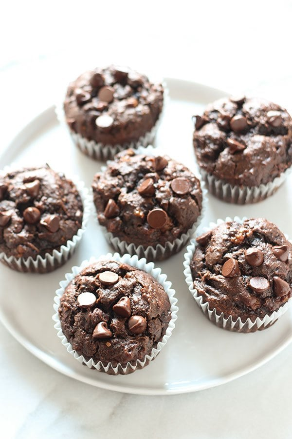 Chocolate Peanut Butter Banana Muffins are made healthier with whole wheat flour, no butter or oil, but tons of flavor! 30 minute recipe.