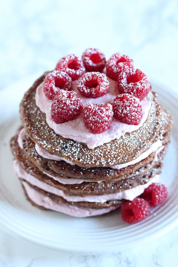 Chocolate Raspberry Pancake Cake features homemade double chocolate pancakes between layers of fresh raspberry whipped cream for a beautifully impressive breakfast treat.
