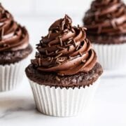 homemade chocolate cupcakes with chocolate frosting swirled on top