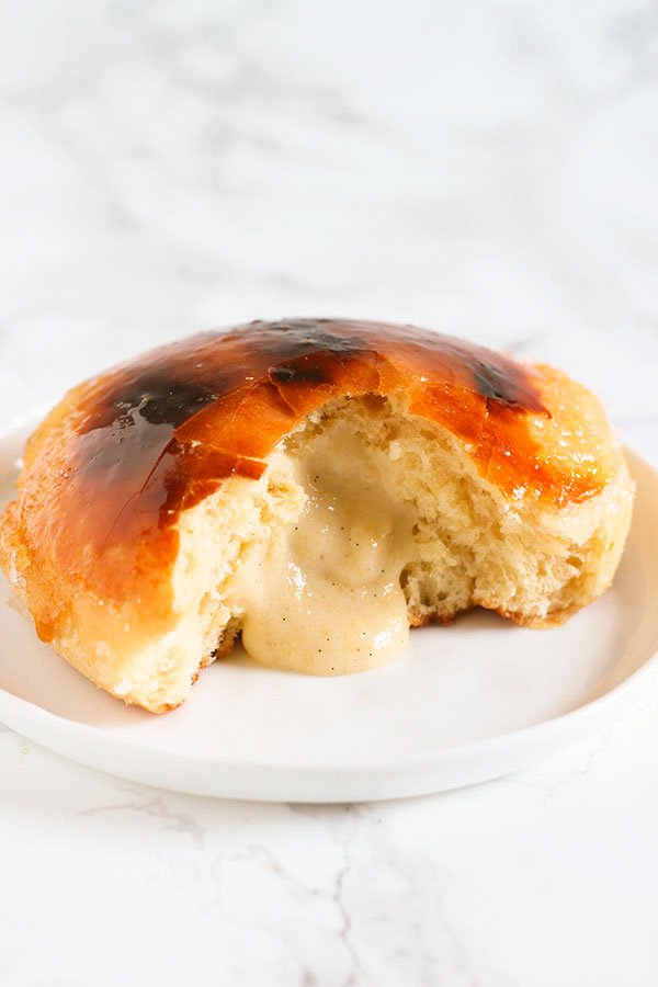 Baked Creme Brulee Doughnuts feature a baked yeast risen doughnut base filled with vanilla bean pastry cream and finished off with a shatteringly crunchy bruleed sugar coating. To die for!