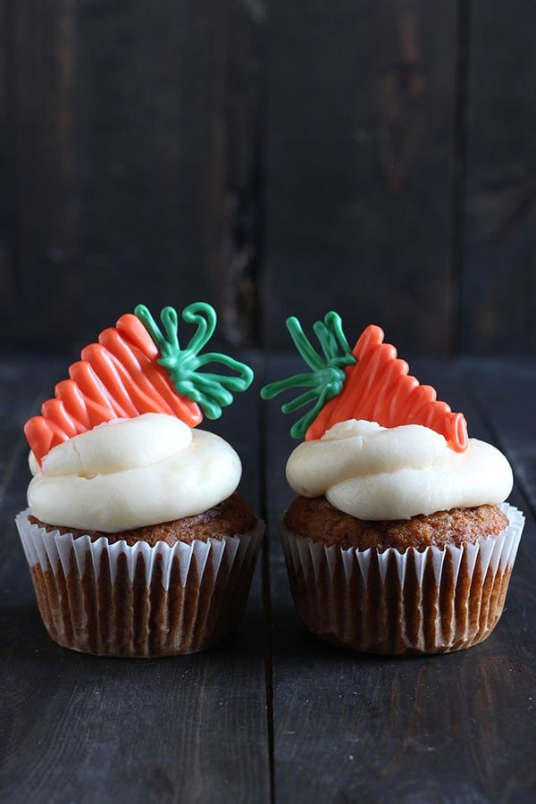 How to Make Decorative Carrots for your carrot cake or cupcakes. Includes a step-by-step video showing THREE ways to make cute carrots: with buttercream, candy melts, and marzipan. Perfect for spring!