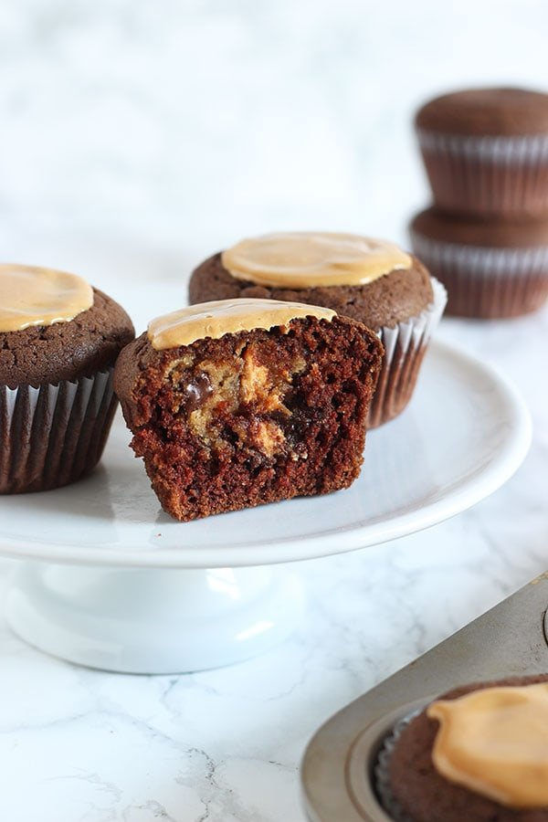 A hidden chocolate chip peanut butter cheesecake filling takes these Peanut Butter Cheesecake Stuffed Cupcakes to a whole new level. You'll LOVE this recipe.