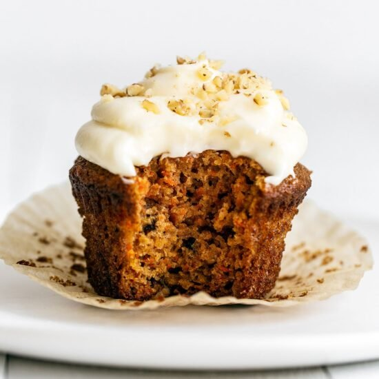Carrot cupcake with bite taken out
