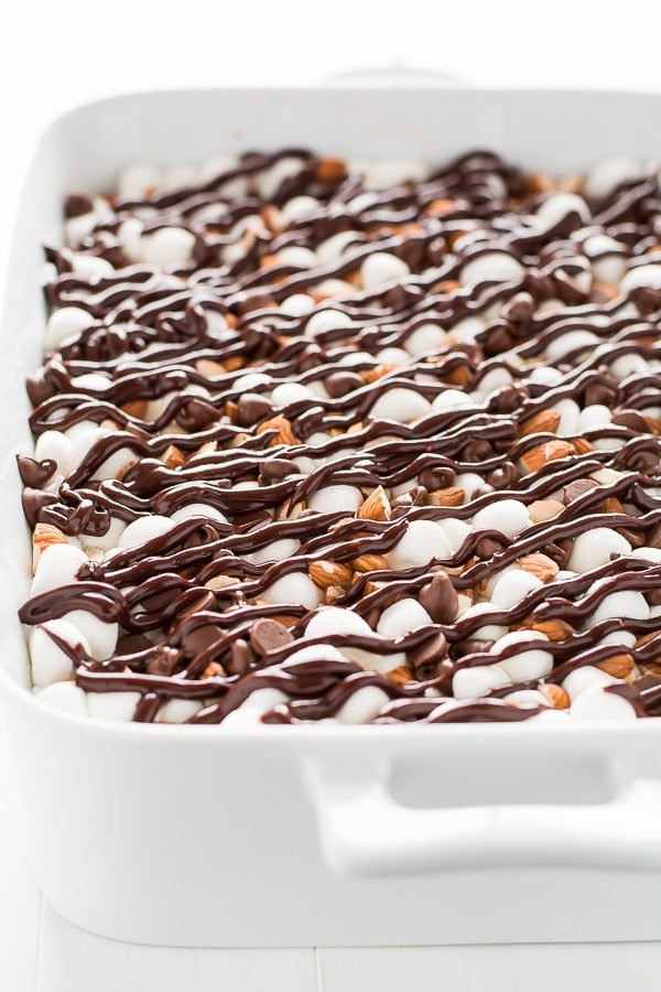 Rocky Road Brownies have a rich chocolate brownie base topped with a layer of puffy marshmallows, sprinkled with chocolate chips and almonds, and drizzled with chocolate frosting.