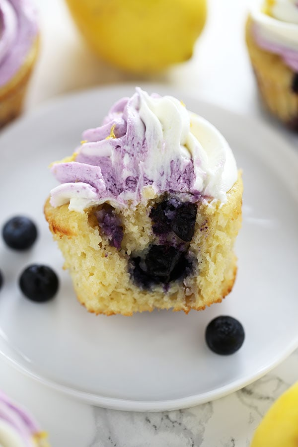 Lemon Blueberry Cupcakes are perfectly tender and moist with tons of fresh lemon and blueberry flavors, plus an easy swirled buttercream for a gourmet look that will impress everyone!